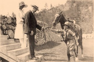 Calvin and Grace Coolidge receiving the gift of a horse
