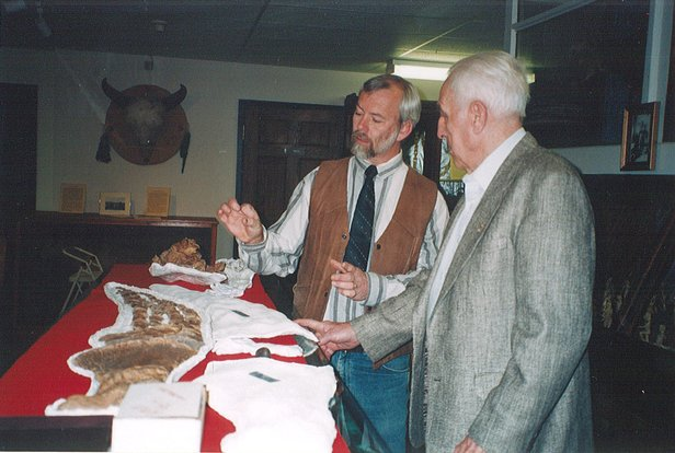 Paleontologist Dr. Gordon Bell talking with Verne Haas, son of plesiosaur discoverer Charles Haas