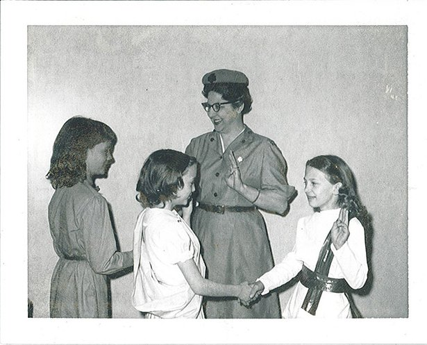 woman instruction girl scouts