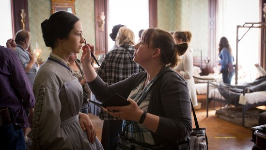 Hannah James, who plays Emma Green, gets a touch up during filming.