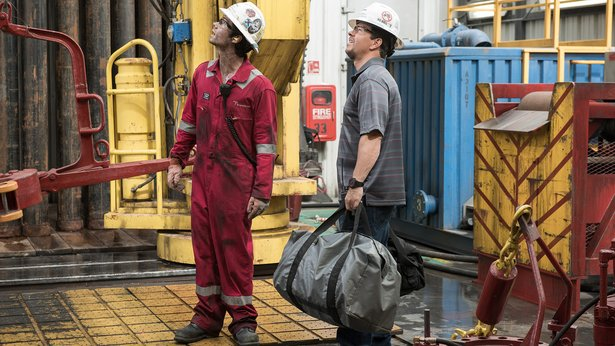 """Caleb Holloway (Dylan O'Brien, left) and Mike Williams (Mark Wahlberg) examine the rig in """"Deepwater Horizon."""""""