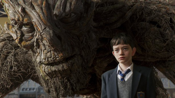 """Conor (Lewis MacDougall) is shadowed by The Monster (performed and voiced by Liam Neeson) in """"A Monster Calls."""""""