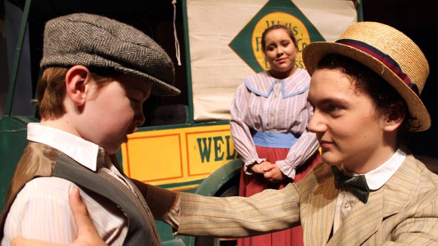 "Harold (Spencer Stribling, right) reassures Winthrop (Grason Derington) as sister Marion (Cassi Gardner) looks on in ""The Music Man."""