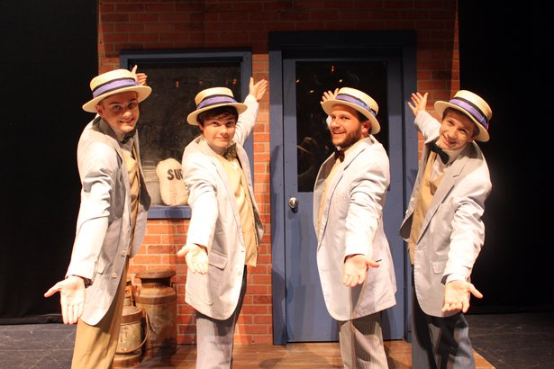 "Kayden Burns, from left, Alex Nair, Brandon Wilhelm and Ethan Worsham sing as a barbershop quartet in ""The Music Man."""