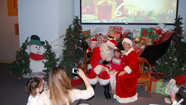 Guests pose for photos with Santa Claus at the annual Christmas Open House at Panhandle-Plains Historical Museum.