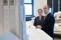 Geoffrey Baer and architect Melissa DelVecchio view building models.