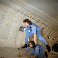 "Christa McAuliffe and Barbara Morgan preview microgravity during a special flight aboard NASA's KC-135 ""zero gravity"" aircraft."