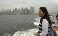 Director Reaghan Tarbell on a New York City ferry with the city skyline.