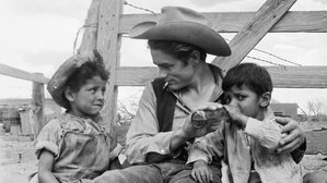 James Dean taking a break from filming Giant on location in Valentine, Texas with local Marfa children, Roberto Marquez (left) and Jose Luis Vasquez (right), during the summer of 1955.