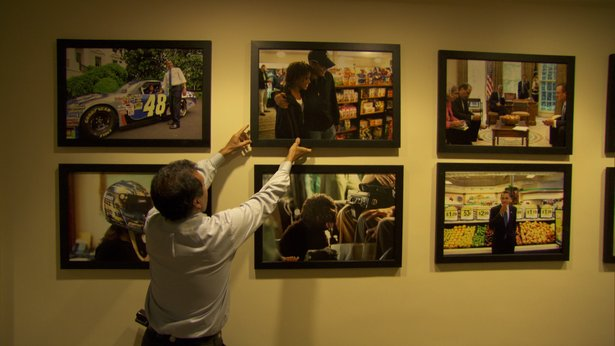 "Pete Souza hangs photos in the White House Gallery. These images, called, ""jumbos"" hang throughout the West Wing of the White House."