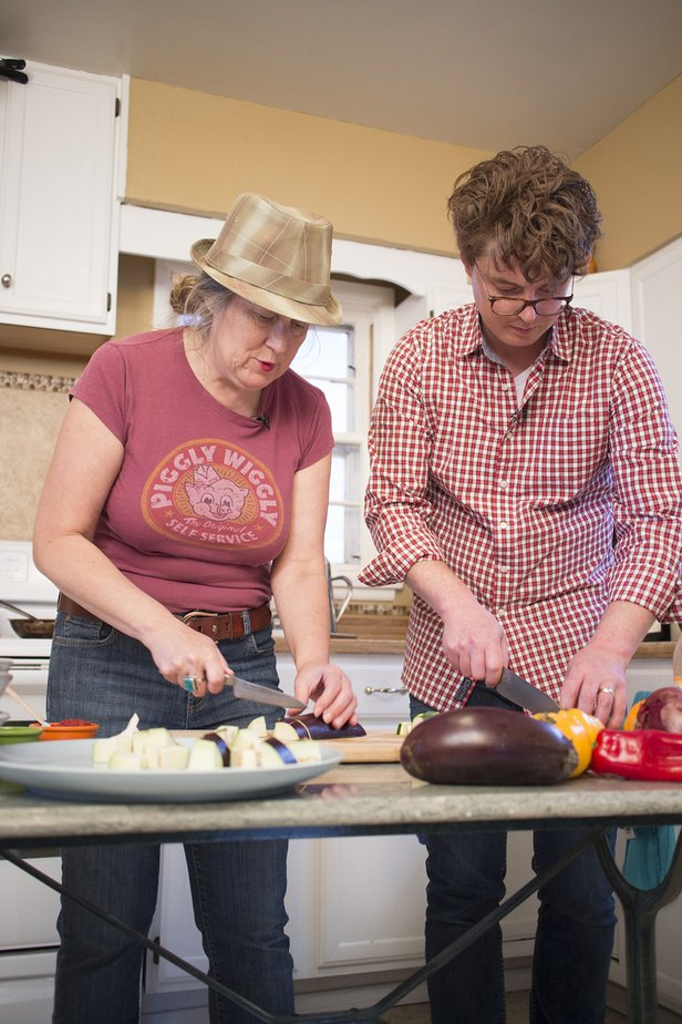 MJ Adams and Michael Haskett prepare vegetables to be added to the Caponata.