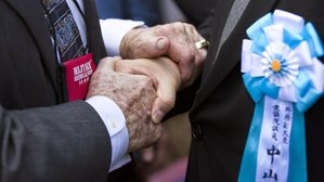 A powerful handshake of friendship on the island of Iwo Jima on March 21, 2015.
