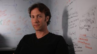 Dr. David Eagleman sitting in his lab - the Laboratory for Perception and Action at the Baylor College of Medicine.
