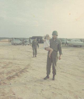 Special Forces SFC Lewis Clark Walton holding Jacke Walton