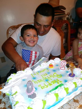 Maria Garcia Juarez missed her son David's second birthday. Here, he cuts a cake with his father, Erick Orozco, in Detroit.