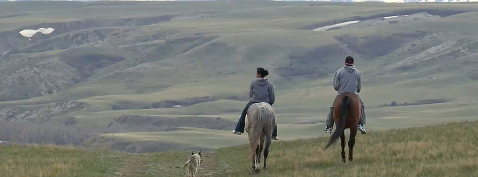 Myles Murray and his aunt, Molly Murray, train their Relay horses near Browning, Montana