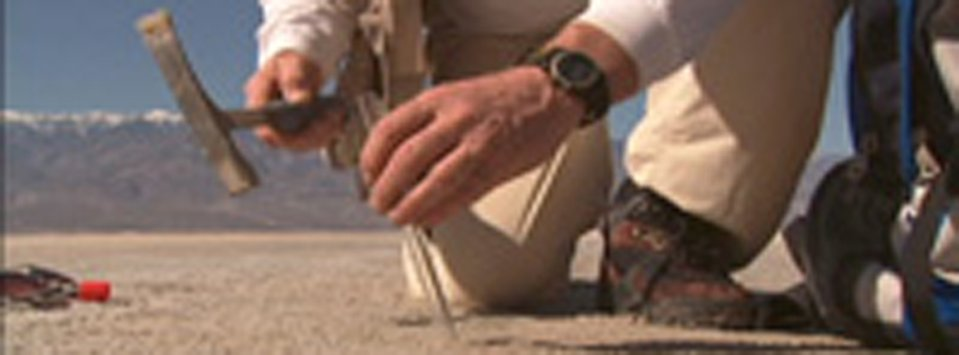NASA scientist collecting sample in Death Valley.