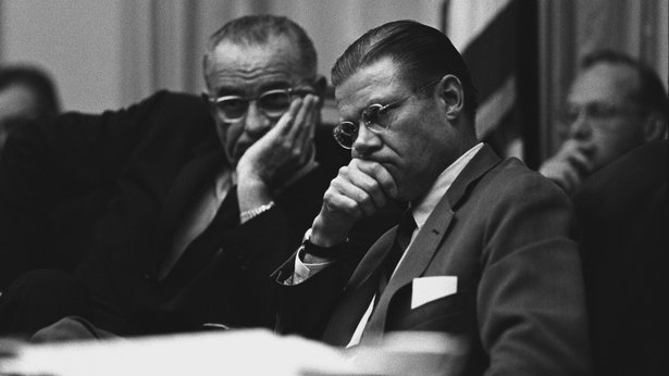 A black-and-white image of President Lyndon B. Johnson and Secretary of Defense Robert McNamara in the White House Cabinet Room.