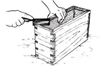 """""""Kerfing in"""" a box made with mitered corner dovetails."""