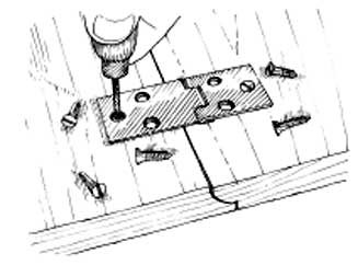 Make holes for the screws with a bradawl after countersinking the barrel of the hinge.