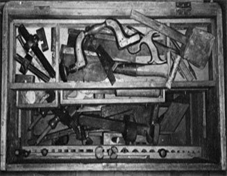 Inside the chest. The rack of moulding planes is concealed beneath the sliding tray.