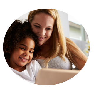 A circular image of a smiling woman and a little girl looking at a tablet computer together