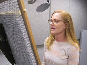Marg reading the letters at an NET studio