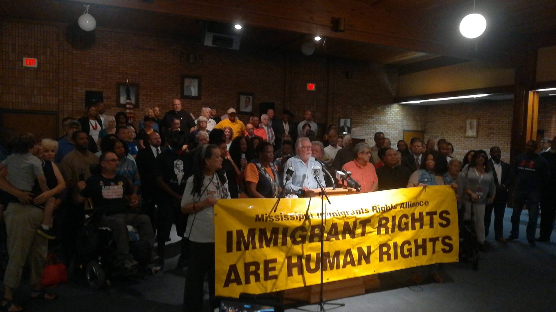Rally supports migrants as 300 return home