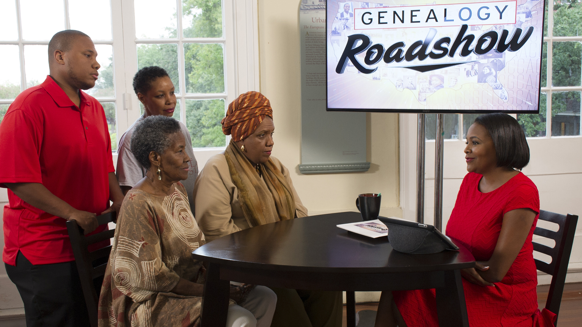 A scene from Genealogy Roadshow with Kenyatta D. Berry.