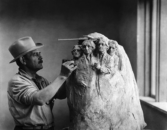 Gutzon Borglum with an early model of Mount Rushmore
