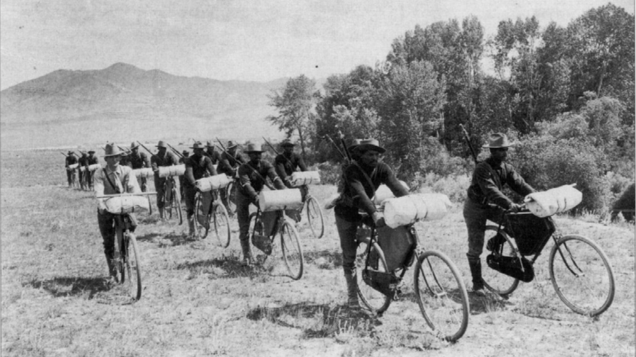 The 25th Infantry Bicycle Corps loaded down with weapons and gear.