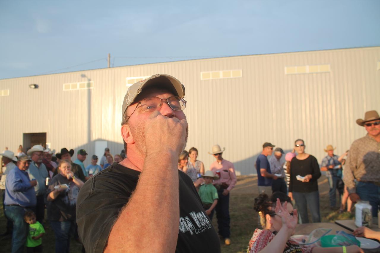 Festival organizer Brad Derschan enjoys a mountain oyster raw.