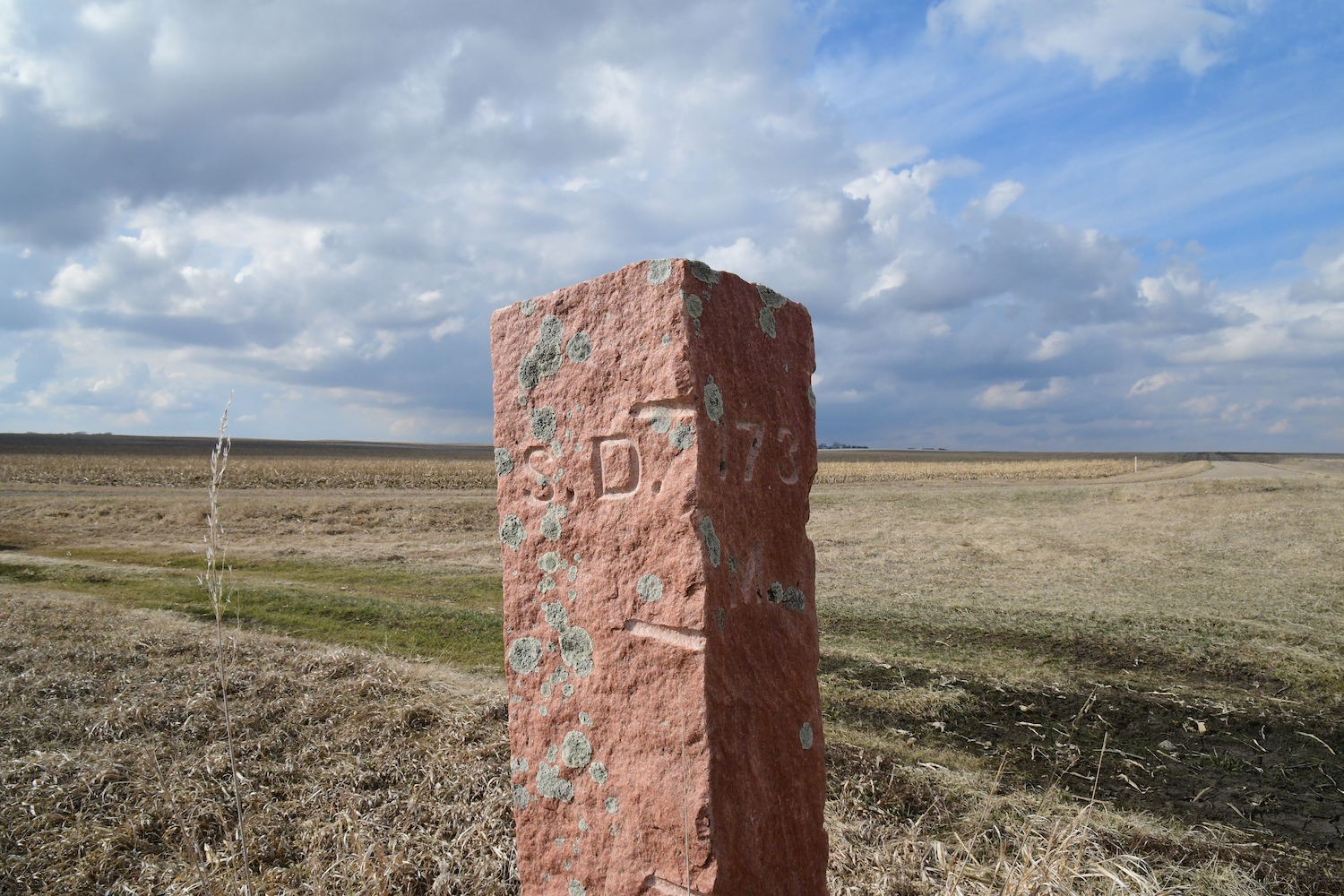 """173 M."" marks the east face of the post for mile 173."