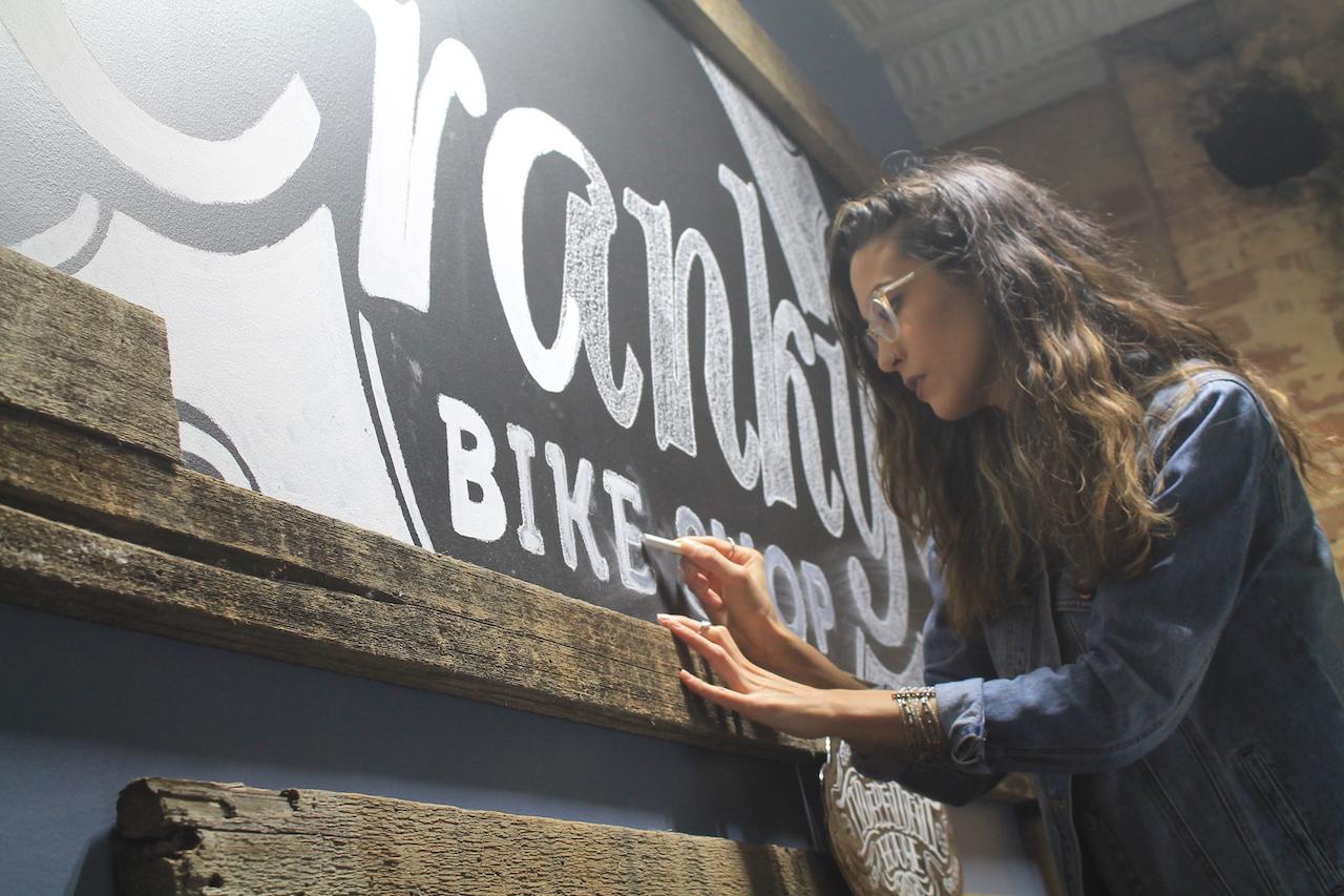 Laurel Antonmarchi at work at Cranky's Bike Shop.