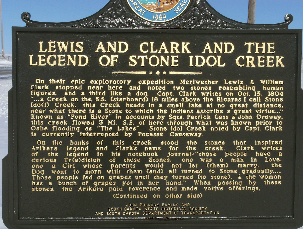 A South Dakota State Historical Society marker about the Stone Idol legend, outside Pollock.