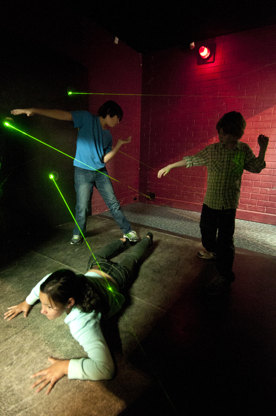 "Kids navigate a laser maze in this promotional picture for ""Top Secret: License to Spy."""