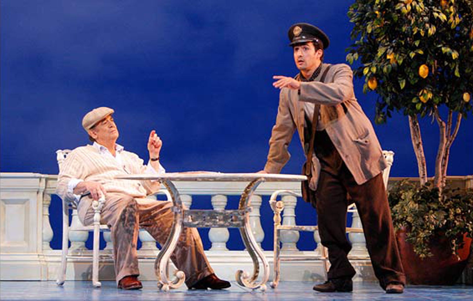Plácido Domingo as Pablo Neruda and Charles Castronovo as Mario Ruoppolo in Il Postino.