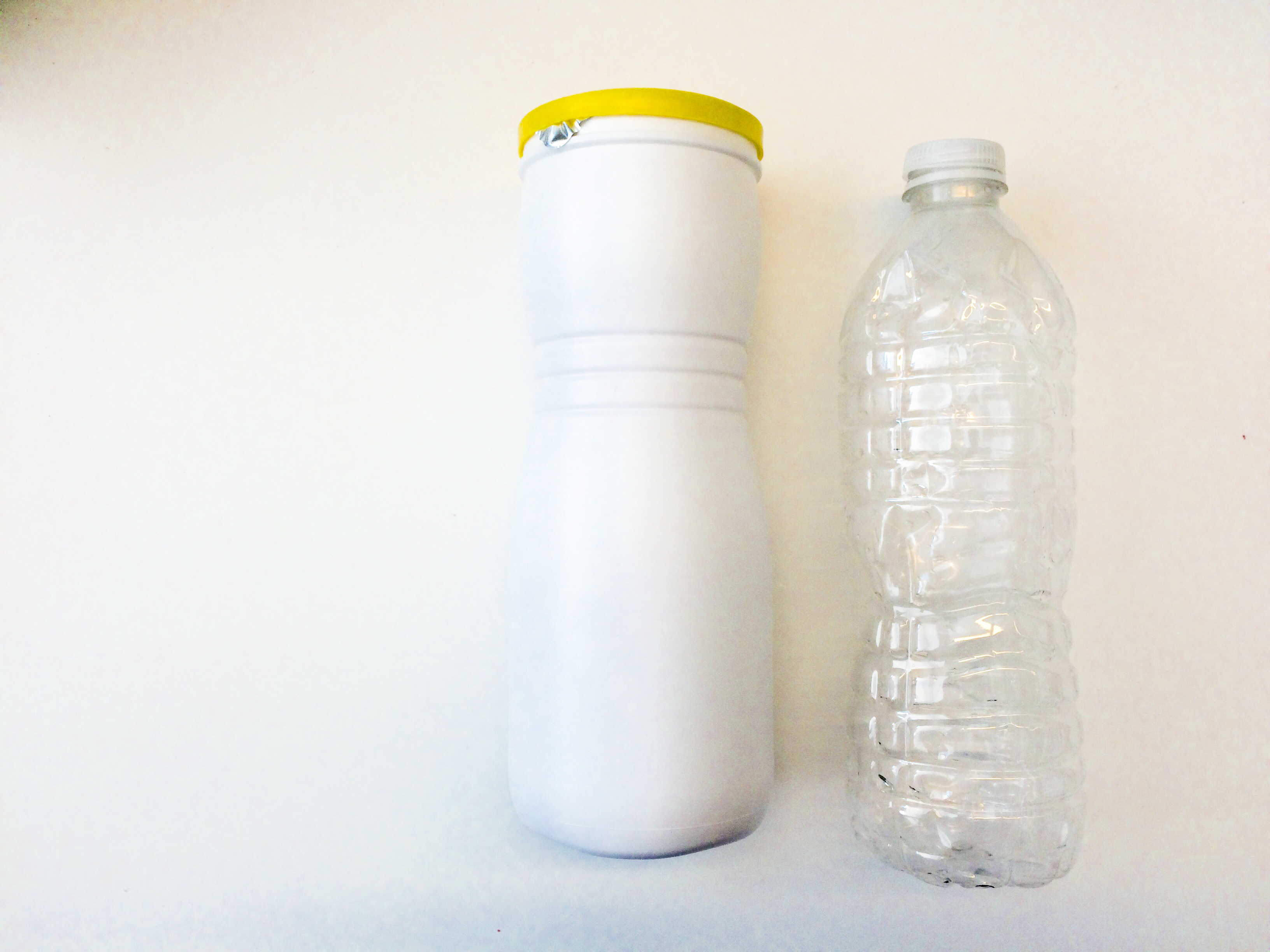 White cylindrical container and water bottle.