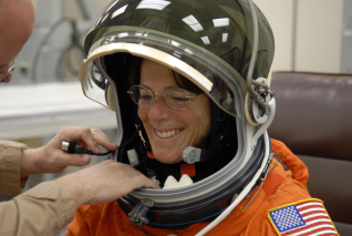 STS-118 Mission Specialist Barbara R. Morgan gets the fit of her launch-and-entry suit checked by a tech as part of the prelaunch prep.