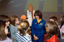 "Educator astronaut Barbara Morgan speaks with students during Space Center Houston's ""Meet an Astronaut Day."""