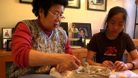 Kelly Wong & Grandma make shrimp dumplings.