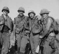 Members of the U.S. Army's 23rd Division share a moment of camaraderie in the field in 1969.