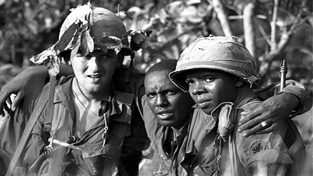 Three soldiers in the Vietnam War.