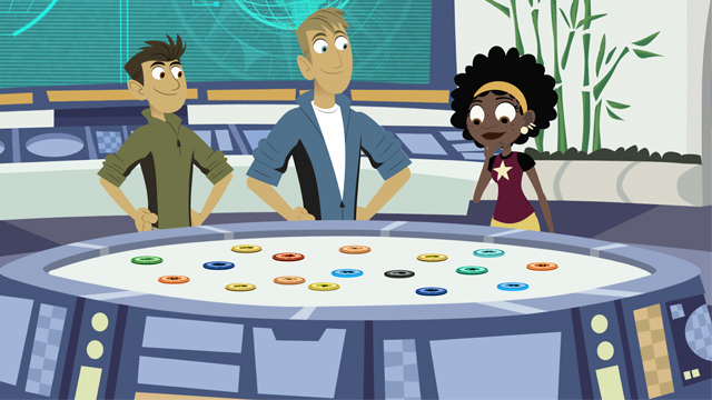 "Wild Kratts ""Back in Creature Time"" promotional image with Chris, Martin and Koki around a table"
