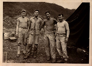 Jim with soldiers during Korean War.