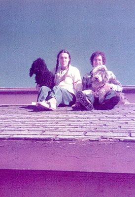 Zoe (left) sitting on roof with dog.