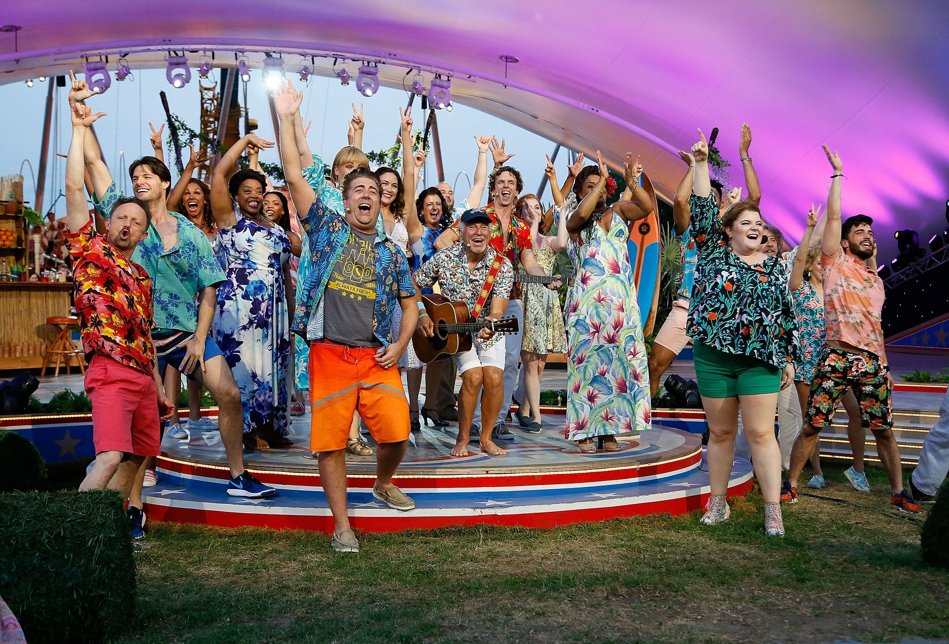 Jimmy Buffett and the cast of Escape to Margaritaville perform together at the 2019 <em>A Capitol Fourth</em>.