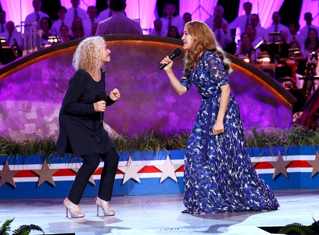 "Carole King and Vanessa Carlton perform ""I Feel the Earth Move"" at the 2019 <em>A Capitol Fourth</em>."