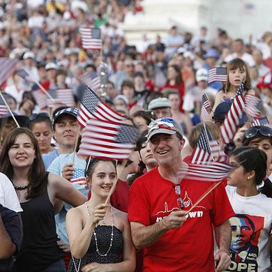 Crowd of people waving flags