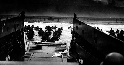 Soldiers land on the beaches of Normandy on D-Day.